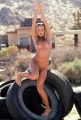 Jaime Pressly doing yoga inside the tire