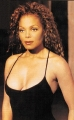 Janet Jackson in black sexy dress with plunging neckline