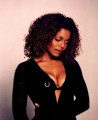 Janet Jackson wearing black dress with plunging neckline