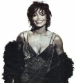 Janet Jackson posing in party dress