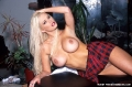 Jenna Jameson posing topless in amazingly short skirt