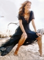 Jennifer Aniston in fantastic dress is posing in the wind