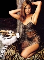 Jennifer Aniston posing in tiger styled lingerie