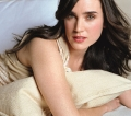 Jennifer Connelly posing in bed