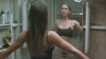 Jennifer Connelly posing in the mirror wearing only bra