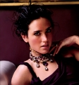 Jennifer Connelly posing in black dress