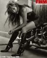 Jennifer Lopez in black lingerie and leather boots