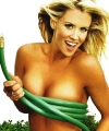 Jenny McCarthy playing topless in the garden