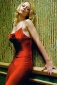 Jeri Ryan posing in beautiful red dress