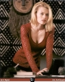 Jeri Ryan wearing sexy blouse with hot neckline