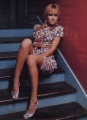Jessica Alba posing on the stairs showing nice legs