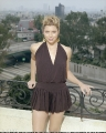 Jessica Biel posing on a balcony in nice dress