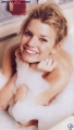 Jessica Simpson posing covered with foam in the bath