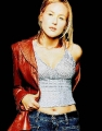 Jewel Kilcher posing in red leather coat