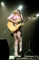 Jewel Kilcher wearing short skirt on concert