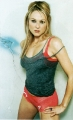 Jewel Kilcher posing in red lingerie