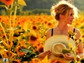 Hot Julia Roberts posing on the field of sunflowers