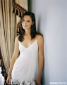 Katie Holmes posing in white dress with sexy neckline