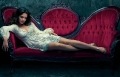Katie Holmes posing in hot dress on a stylish coach