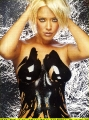 Kristanna Loken posing topless covered with paint