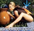 Kristanna Loken showing her outstadning legs in the garden