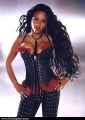Lil Kim wearing hot leather corset