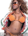 Lil Kim posing in orange hot bikini