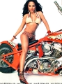 Lil Kim posing in hot bikini on the red harley davidson