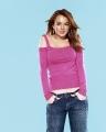 Lindsay Lohan posing in pink blouse