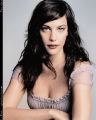 Liv Tyler posing in sexy dress with plunging neckline