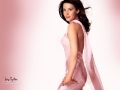 Liv Tyler posing in pink dress