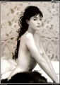 Monica Bellucci posing topless