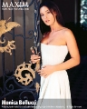 Monica Bellucci posing in hot dress with plunging neckline