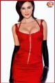 Monica Bellucci posing in red hot dress with sexy neckline