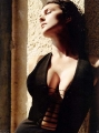 Monica Bellucci posing in hot black dress