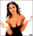 Monica Bellucci posing in black sexy dress with plunging neckline