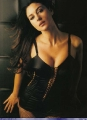 Monica Bellucci posing in black hot lingeire