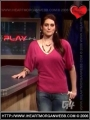 Morgan Webb on red blouse