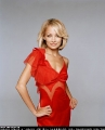 Nicole Richie posing in red sexy dress with hot neckline