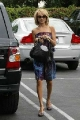 Nicole Richie by her car