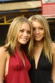 Olsen Twins with a very cute smiles on their faces
