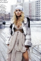 Ashley Olsen posing in amazing fur dress