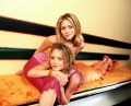 Olsen Twins posing together in colorful clothes