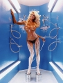 Topless Pamela Anderson is painting herself in Miracle Tan