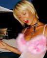 Paris Hilton with a cherry in her mouth wearing pink sexy dress