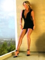 Rachel Hunter wearing black dress with hot plunging neckline