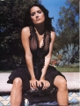 Salma Hayek posing in black hot dress