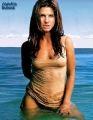 Sandra Bullock posing in sexy wet dress in the water