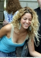 Shakira wearing blue shimmy with deep neckline
