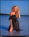 Shakira posing in the water